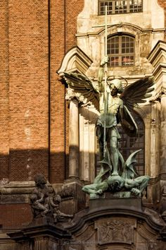 Good vs. Evil. Archangel Michael fighting Satan. Bronze statue at St. Michaels Church in Hamburg, Germany.