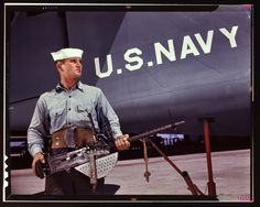 """August 1942. Corpus Christi, Texas. """"After seven years in the Navy, J.D. Estes is considered an old sea salt by his mates at the Naval Air Base."""" 4×5 Kodachrome transparency by Howard Hollem, Office of War Information."""