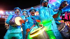 PERFORMERS:    Dancers decked out in blue suits perform during the ceremony.