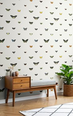 Delicate garden creatures like butterflies are a Cottagecore staple. This butterfly wallpaper brings an air of botany and whimsy with it, and looks great paired with stylishly vintage, Mid-Century furniture.Don't forget to place potted plants around the room to give your space even more of a wildlife garden vibe.