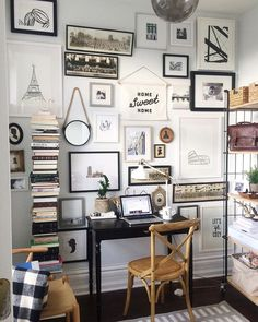 Art wall of modern and vintage prints and artwork over a small desk