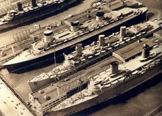 Three of the worlds largest ocean liners moored together in NY harbor 1940.