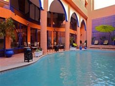 The nice swimmingpool of hotel Le trois Palmiers