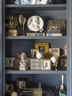 Bookcase Decorating Ideas... 'Collector's Library' - an exquisite grey/blue color scheme, and shelves crammed with treasures.