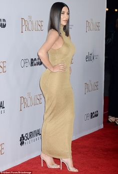 Gorgeous: Kim Kardashian put on an eye-popping display in a skintight gold dress at The Promise premiere in Hollywood on Wednesday