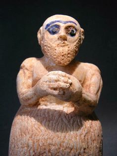 This sitting priest has his hands clasped in an attitude of prayer. He is wearing a typical woven robe and is naked above the waist. (Typical for this kind of statues). He is wearing a long heavy beard, the eyes and eyebrows are emphasized with bleu glazed colored inlay.   Origin: Mari Syria Date: 3000 BC to 2500 BC.