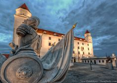 Bratislava Castle with a Roman Statue on the Gate in Front. HDR effect gives a feeling of a haunted castle in Slovakia, guarded by the soldiers at night. Bratislava Slovakia, Roman Soldiers, Hdr Photography, Romans, Statue Of Liberty, Castle, Around The Worlds, College, City