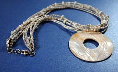 Beaded Necklace with Carved Shell Donut and Silver Plated Lobster Clasp by TurquoiseGraphics, $50.00