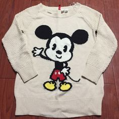Knitted Mickey Sweater Knitted cream/beige Mickey Mouse sweater. Been worn a few times but it is in great shape. Thick material and very comfortable. There is a few loose stitching as pictured. It is an H&M size 6 so it is can probably be oversized on a small or fit well on a medium. **I can only ship out on Fridays and weekends. Sorry** H&M Sweaters Crew & Scoop Necks