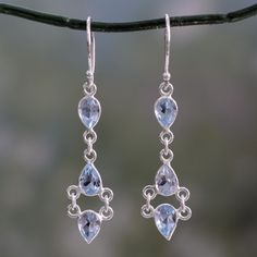 Novica Handmade Sterling Silver 'Mystic Wonder' Blue Topaz Earrings (India) (Solid), Size 10 mm wide x 50 mm long Story Behind the Art: Indian silversmith Bhavesh says, 'Jewelry crafting is our family tradition, dating back to the times of Maharaja Sawai Jai Singh II in Jaipur