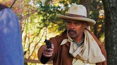 """Guy Davis was cast as the famed deputy U.S. marshal in """"Bass Reeves and the Brunter Brothers,"""" a 2017 episode of Tales of the Wild West. An unexpected plot twist has Davis' Reeves partnered with Richard Cutting's Wyatt Earp in tracking the wanted (and fictional) Brunter Brothers. Wyatt Earp, Western Movies, Plot Twist, Wild West, Panama Hat, Cowboy Hats, Bass, It Cast, Hollywood"""