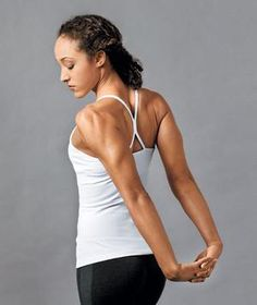 http://www.realsimple.com/health/fitness-exercise/stretching-yoga/stretching-exercises Woman stretching her arms behind her back