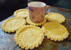 Free Crochet Pattern for FLOWER CUP COASTER...these are so cute, I love the raised ruffled edge!!