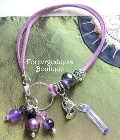 """Item# LWPB 01  Length : 8 """"in. We have purple Suede Cord with Pale purple crystal Large hole Bead, add a bit of silver bali spacers and silver ring. It becomes a unique piece of jewelry. Silver witch's hat Charm , Purple crystal bead, purple pearl , amethyst , Purple/blue aura point. as a dangles , in the end of the bracelet. Gemstone: Amethyst: Protection, cleansing and energizing, for complete info go to boutique. price $11.25 + free ship usa"""