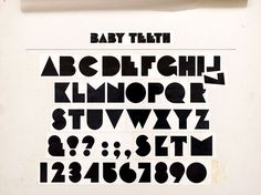 Milton Glaser's Baby Teeth font. Hand-drawn - and something like it is on Joanna Newsom's Have One on Me