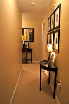 How to decorate a narrow hallway....  www.seasideinteriors.ca
