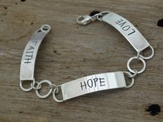 FAITH HOPE LOVE bracelet  hand fabricated in sterling silver $85.00 by JoDeneMoneuseJewelry