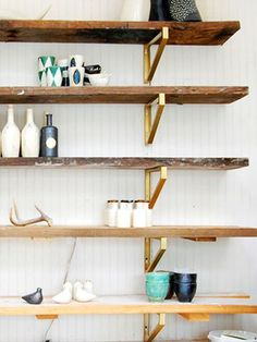 Chic Ikea Hacks - These gold brackets with paired with reclaimed wood shelves make a stunning wall shelving unit