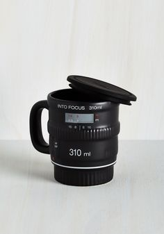 Pour and Shoot Mug. Focus on the bold flavor and rich color of your signature brew, as you zoom through your morning routine with this clever camera-inspired mug in your clasp! #black #modcloth