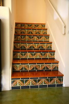 Talavera Tiled Stairs And Green Acid Stained Concrete Floors.