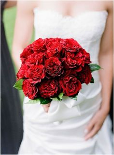 Red Garden Rose Bouquet the bridesmaid bouquets were filled with red peonies, red