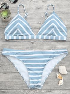AD : Chevron Striped Cami Bikini Set - BLUE AND WHITE Minimal coverage striped bathing suit featuring adjustable shoulder straps triangle-shaped bikini top and hipster swim bottoms, padded. Swimwear Type: Bikini Gender: For Women Material: Nylon,Polyester,Spandex Bra Style: Padded Support Type: Wire Free Collar-line: Spaghetti Straps Pattern Type: Striped Waist: Low Waisted Elasticity: Elastic Weight: 0.2000kg Package: 1 x Top 1 x Bottoms
