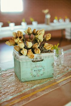Vintage yellow rose centerpieces.  Photo by Amanda Watson Photography. www.wedsociety.com  #wedding #centerpieces