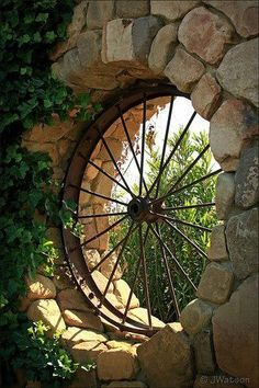 Old wagon wheel as a window
