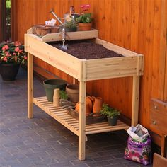 You'll go potting mad when you start to use this Potting Bench Garden Planting Table in Unfinished Cedar Wood. Garden Sink, Garden Table, Garden Oasis, Potting Tables, Potting Soil, Climbing Flowers, Backyard Makeover, Bench With Storage, Edible Garden
