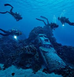 """Tourists diving on Easter Island's reef encounter a fake moai, made for a 1994 Hollywood movie and then sunk offshore."" Photograph by Randy Olson From ""Easter Island,"" National Geographic, July 2012 Places To Travel, Places To See, Magic Places, Historical Sites, Belle Photo, National Geographic, Scuba Diving, Wonders Of The World, South America"