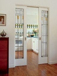 craftman style stained glass pocket doors, lets in light and adds a splash of color. Would save room between dining and living