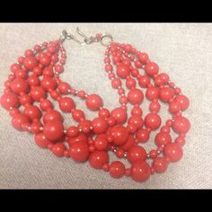 Coral orange necklace Coral orange necklace. Choker style. Accented with tiny gold beads. Talbots Jewelry Necklaces