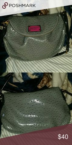 100% Authentic Marc By Marc Jacobs Crossbody Beautiful used gray  Marc By Marc Jacobs bag well taken care of. No rips or tears inside the bag it self but the strap it self does have some ripping  and cracking and a small part on the left side of the purse where it folds. Marc by Marc Jacobs Bags Crossbody Bags