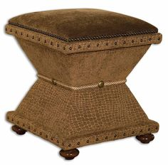 Tailored, handwork flaunting rows of brass nails, button accents, and silken rope trim. Plush covering is satiny taupe reptile chenille with antiqued velvet cushioned top. Rich, walnut stained hardwood feet.