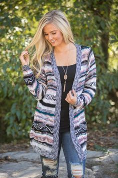 This beautiful cardigan is simply perfect for cozy fall mornings! We adore the lovely color combination - it has stripes ofblack, white, pink, teal, orange, mustard, purple, and light blue for a beau