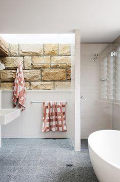 Palm Beach Bungalow | Stephen Collins Interior Design | Sandstone bathroom