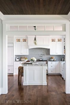 White kitchen with dark wood floors. Classic kitchen, timeless kitchen that will last for years.