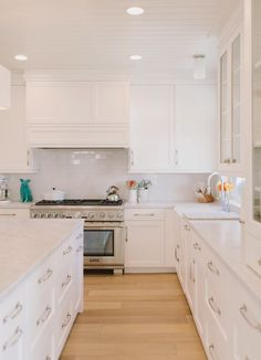 Warm floor and white cabinets