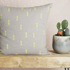 Grey Double Spike Cushion Cover: Holly's House are excited to bring to you our Spring/Summer collection which showcases Native American influenced patterns printed on pastel linens alongside industrial furniture pieces to keep your home bang on trend. The grey double spike cushion has been lovingly hand printed.