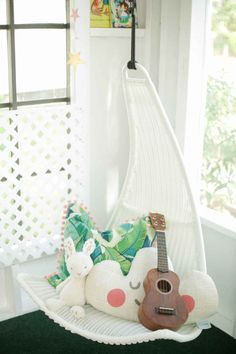 toddler reading nook / Ikea Svinga hanging chair