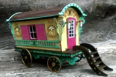 This is a do it yourself kit for making a Gypsy Wagon.   All of the pieces are pre-cut cardboard.  You get to build your caravan and decorate it any way you like.  The finished caravan measures 7 long 5 high and 4 wide. It is 1/24 scale.  There is a lot of detail to this caravan. there is a bench and table inside. There are little lanterns on each side on the door. The door opens and the wheels turn. There is even a set of steps.  The roof is removable so it is easy for you to access the…