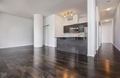 Burano Lofts and Condos-832 Bay St #211 | Rare, one-of-a-kind 1033 sf 2 bedroom in original part of the building with 7 ft high arched warehouse windows, 10 ft high ceilings, and large angled east window wall. 1 Parking & 1 Locker included. | More info here: torontolofts.ca/burano-lofts-and-condos-lofts-for-sale/832-bay-st-211 High Ceilings, Window Wall, Condos, Lofts, Windows 10, Warehouse, Lockers, Hardwood Floors, Arch