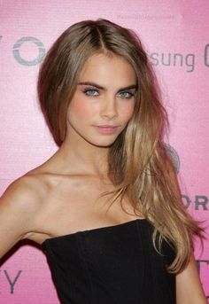 Cara Delavingne. A touch of pink on her cheeks and her