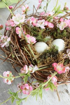 spring nest with flowers and eggs