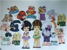 Large? paper dolls with lots of clothes 70? < SWEDISH  > stora Klippdockor med massor av kläder 70tal?