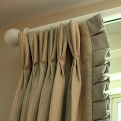contrast stitch of pinch pleat... box pleat trim. great for a boys rooms.