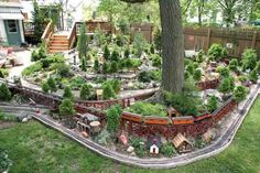 This outdoor railroad feature numerous trestles, four ponds, and hundreds of dwarf confiers. Garden… - Home Garden Art, Garden Design, Garden Railroad, Model Train Layouts, Fairy Houses, Model Trains, Toy Trains, Backyard, Landscape