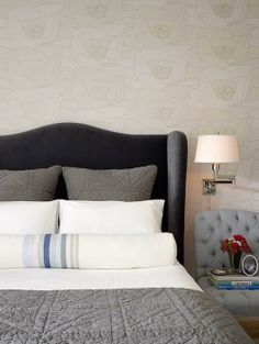 Matelasse bedding, tuffed chair, bedside sconces, basically neutral color scheme  By Jute Home