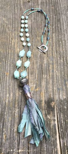 Beaded necklace with amazonite, crystal and miyuki seed beads with sari silk tassel and toggle clasp