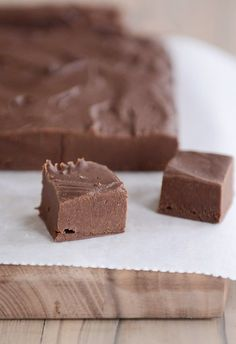 This easy homemade fudge is creamy, rich, and SO delicious, and it comes together in less than 15 minutes with tons of add-in options! #homemadefudge #fudgefromscratch #fudge #holidaytreats #easytreats #homemade #dessert #treats #neighborgifts #meslkitchencafe